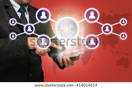 Businessman using the smart phone with the Social media symbol on red color background with world map, Elements of this image furnished by NASA, Business network concept
