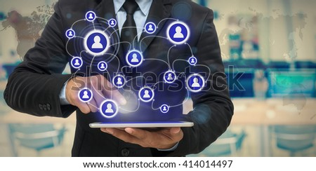 Businessman using the tablet for social connection on blurred photo of computer room background, Elements of this image furnished by NASA, Business network concept