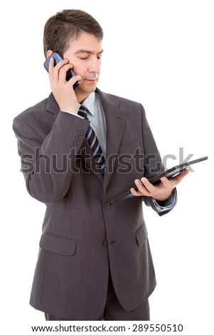 businessman using touch pad of tablet pc, on the phone, isolated - stock photo