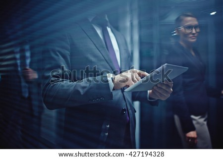 Businessman using touchpad at office - stock photo