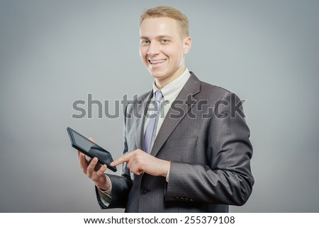 businessman using touchpad on grey background - stock photo