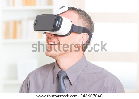 Businessman using virtual reality headset at the office