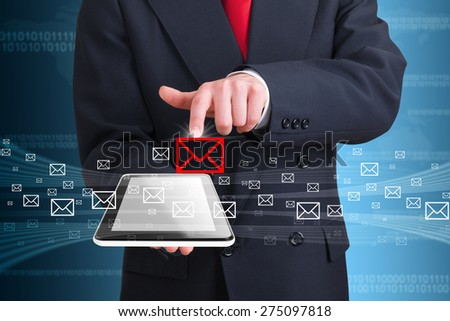 businessman using wireless technology to manage messages - stock photo