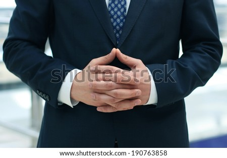 Businessman waiting with folded hands  - stock photo