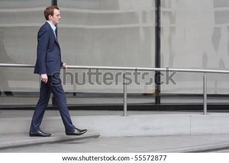 Businessman walking - stock photo