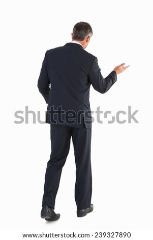 Businessman walking and doing gesture on white background