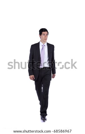 Businessman walking and looking away isolated on white (some motion blur) - stock photo