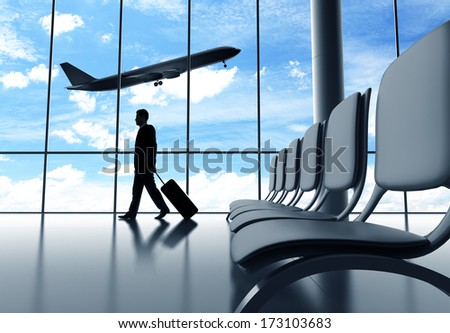 businessman walking in airport  and airplane in sky