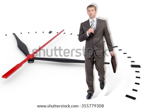 Businessman walking in big clock on isolated white background