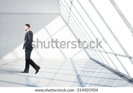 businessman walking in big office - stock photo