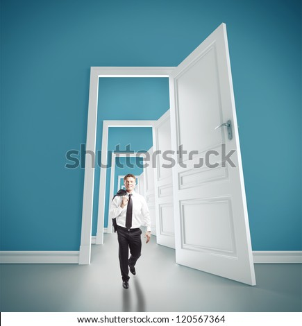 businessman walking in blue room with doors open - stock photo