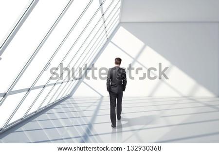 businessman walking in loft office - stock photo