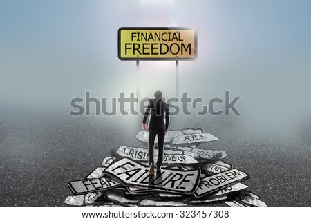 businessman walking  in the mist on problems to goal, financial freedom concept - stock photo