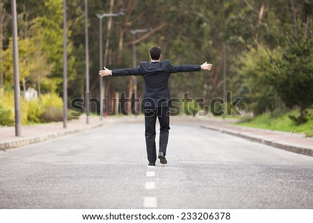 Businessman walking in the road line - stock photo