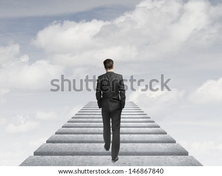 businessman walking in the sky - stock photo