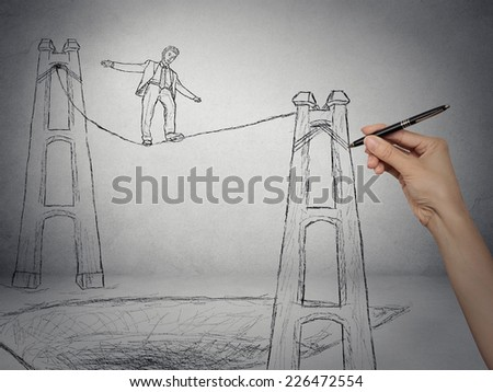 Businessman walking on a rope balancing on high altitude above deep hole, risk in business, competition concept. Sketch drawn by human hand on grey wall background  - stock photo