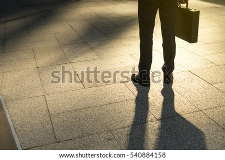 businessman walking on city, focus to foot walk step, abstract business concept, copy space on Left side.