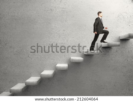 businessman walking on concrete ladder - stock photo