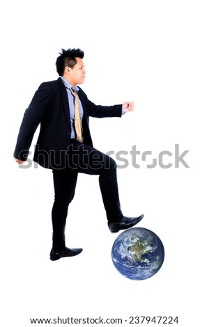 businessman walking on earth,Elements of this image furnished by NASA
