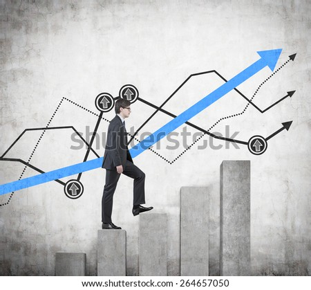 businessman walking on graph in concrete room - stock photo