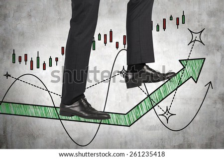 businessman walking on green arrow - stock photo