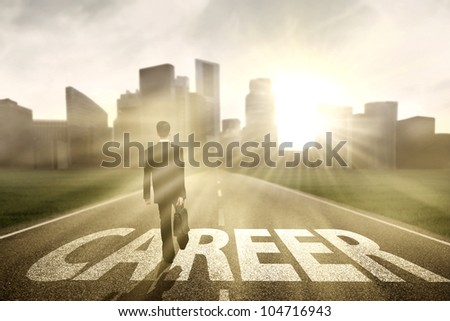 Businessman walking on the right way for a better career