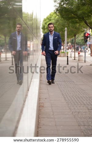 Businessman walking on the street - stock photo