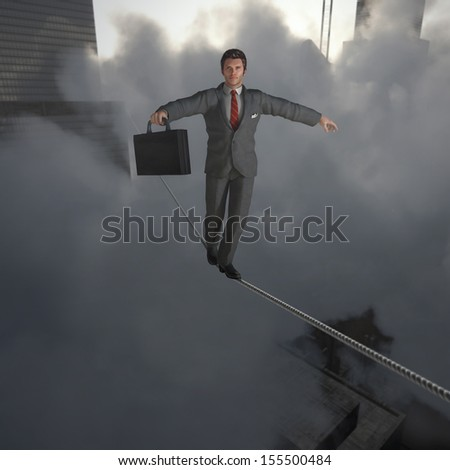 Businessman walking on Tightrope - stock photo