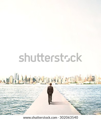 businessman walking to city on concrete bridge - stock photo