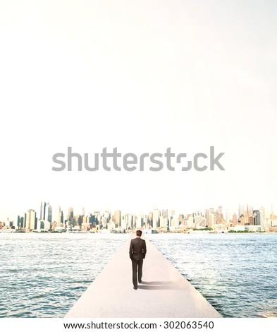 businessman walking to city on concrete bridge - stock photo
