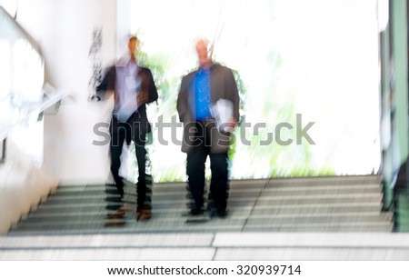 Businessman walking up to stairs, blur, London