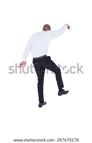 Businessman walking with arms up on white background
