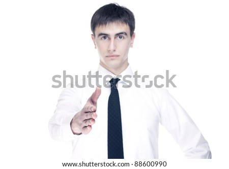 businessman wanting to shake hand - stock photo
