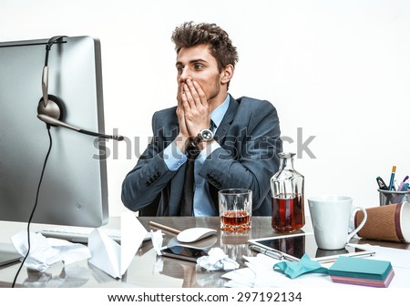 Businessman was horrified to look at the computer screen  / modern office man at working place, depression and crisis concept - stock photo