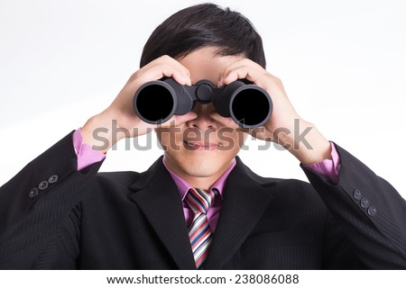 Businessman watch with binoculars for his vision  - stock photo