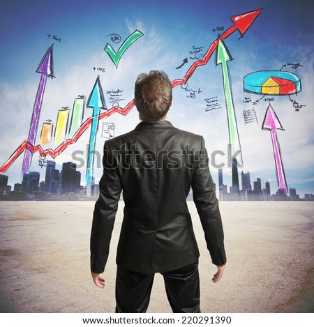 Businessman watchs successful statistics of a company - stock photo