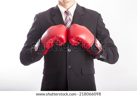 Businessman wear red boxing gloves with white background - stock photo