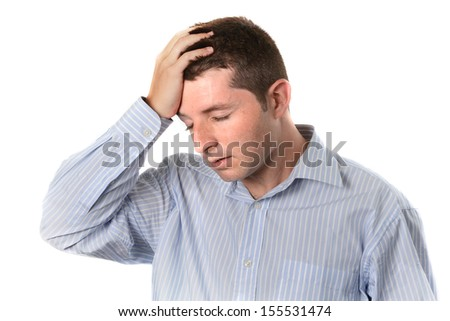 businessman wearing a blue business shirt is over worked and with a headache on a white background - stock photo