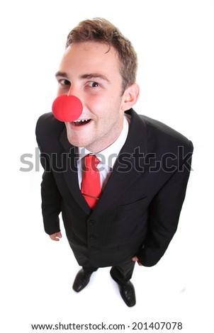 Businessman wearing a clown nose - stock photo