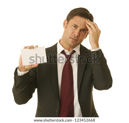 Businessman wearing a suit holding a message card and rubbing his forehead in worry - stock photo