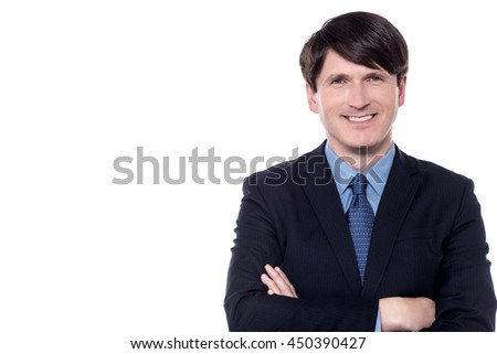 Businessman wearing a suit smiling with his arms folded.