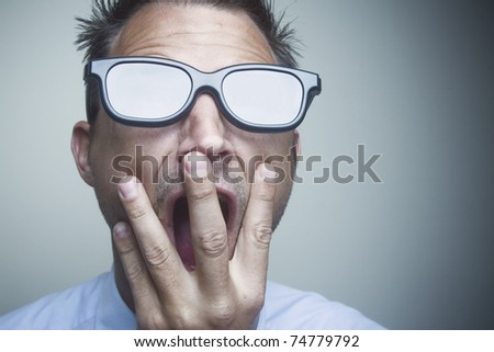Businessman wearing black rimmed glasses with the lenses white from a bright light or explosion. - stock photo