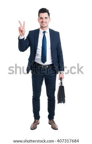 Businessman wearing blue suit and briefcase showing peace gesture or number two isolated on white studio background - stock photo