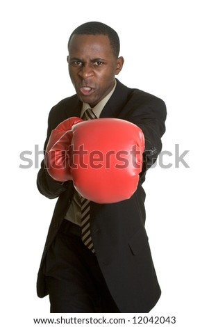 Businessman Wearing Boxing Gloves - stock photo