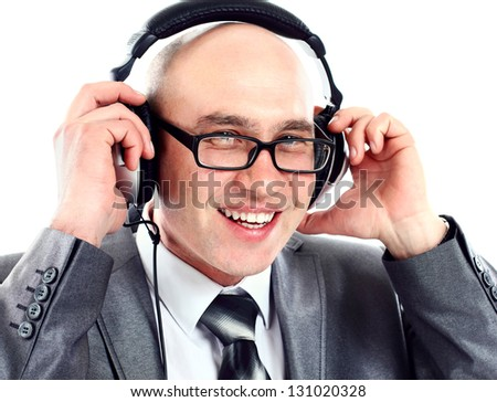 Businessman wearing earphone struggling to hear. Communication concepts.