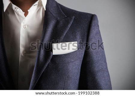 Businessman wearing formal business suit. business card in the pocket