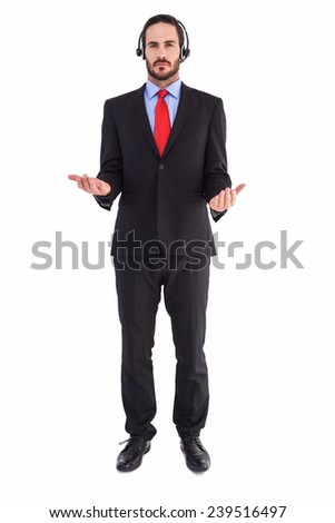 Businessman wearing headphone while holding with hands on white background