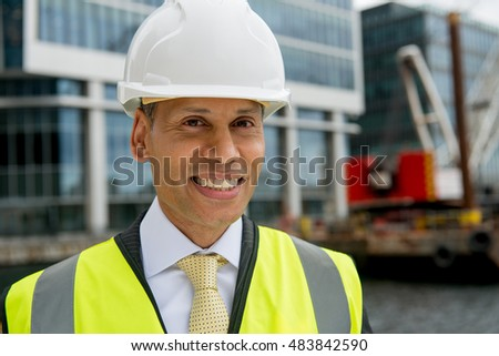 Businessman Wearing Safety Clothing / Helmet