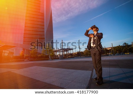 Businessman wearing virtual reality glasses and doing gestures with his hands outdoors. Modern business concept - stock photo
