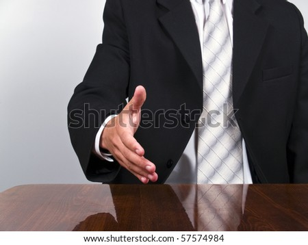 Businessman welcome client or holding hand to handshake (horizontal align) - stock photo